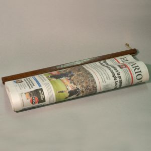 Barra sujeta periódicos